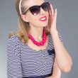 Attractive pinup girl in sunglasses — Stock Photo