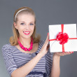 Attractive pinup woman in striped dress with gift - Stock Photo