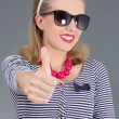 Beautiful pinup girl in sunglasses thumbs up - Stock Photo
