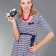 Woman in retro clothes with photo camera — Stock Photo