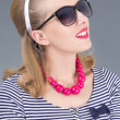 Portrait of attractive pinup girl in sunglasses - Stock Photo