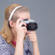 Young woman in retro clothes posing with photo camera - Stock Photo