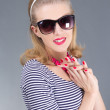 Portrait of young attractive pinup girl in sunglasses - Stock Photo