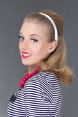 Young attractive blondie pinup girl in striped dress — Stock Photo
