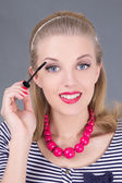Young beautiful woman applying mascara make up on eyes — Stok fotoğraf