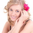 Portrait of young young beautiful woman with flower in her hair — Stock Photo #24072367