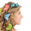 Portrait of young beautiful woman with butterflies in her hair — Stock Photo