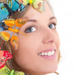 Close up portrait of young beautiful blond with butterflies in h — Stock Photo