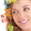 Close up portrait of beautiful blond with butterflies in her hai — Stock Photo