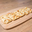 Apple pastry on wooden table — Stock Photo