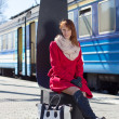 Young beautiful woman waiting for train on the platform  — Stock Photo