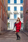 Attractive woman walking in old town of Tallinn — Stock Photo