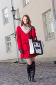 Young beautiful woman walking in Tallinn — Stock Photo
