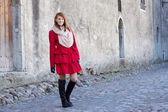 Beautiful redhaired woman walking in Tallinn — Stock Photo