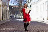 Redhaired woman walking in medieval european town — Stock Photo
