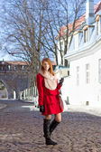 Redhaired girl walking in medieval european town — Stock Photo