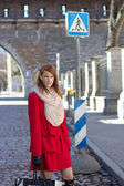 Young redhaired woman crossing the street — Stock Photo