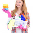Young housewife with cleaning supplies isolated on white backgro — Stock Photo