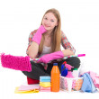 Beautiful woman sitting with cleaning equipment isolated on whit — Stock Photo
