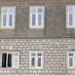 Grey brick wall with six windows — Stock Photo