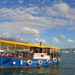 Colorful water bus in harbor of Tivat — Stock Photo #27134603
