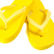 Yellow summer flip flop shoes isolated on white — Stock Photo