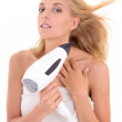 Young woman drying her hair with hairdryer — Stock Photo