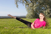 Young woman exercising in park — Stock Photo