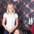 Stock Photo: Hairdresser washing customers hair at a beauty salon