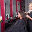 Beautiful hairdresser working in beauty salon — Stock Photo