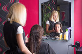 Beautiful hairdresser and customer in beauty salon — Stock Photo