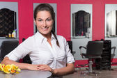 Young female administrator of beauty salon — Stock Photo