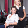 Stock Photo: Young woman and her hairdresser at barbershop