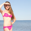 Attractive woman in pink bikini posing on the beach — Stock Photo