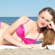Beautiful teenage girl in bikini on the beach — Stock Photo