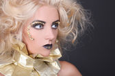 Mysterious woman with blondie shaggy hair and creative makeup — Stock Photo
