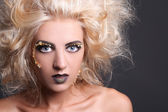 Close up portrait of blondie woman with creative coiffure — Stock Photo