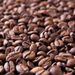 Stock Photo: Brown background from coffee grains close up