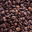 Brown roasted coffee beans, background texture — Stock Photo #30630149