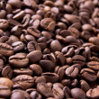 Brown background from coffee grains close up — Stock Photo