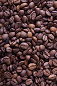 Brown roasted coffee beans, background texture — Stock Photo