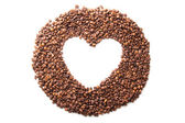 Coffee beans in the shape of a heart isolated — Stock Photo