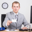 Businessman offering card in his office — Stock Photo #31363273