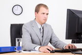 Businessman working with personal computer in office — Stock Photo