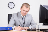Young businessman working in bright office — Stock Photo