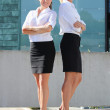 Stock Photo: Two young attractive business women outdoor