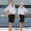 Stock Photo: Two young attractive business women posing outdoor
