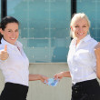 Two business women thumbs up with euro banknotes — Stock Photo