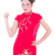 Attractive girl in red japanese dress with chopsticks isolated o — Stock Photo