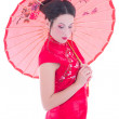 Portrait of girl in red japanese dress with umbrella isolated on — Stock Photo
